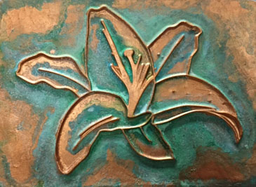 A bas-relief created with GOLDEN High Solid Gel, painted with a mix of Iridescent Copper and Iridescent Copper Light and a number of GOLDEN Fluid paints were used to create an aged patina.